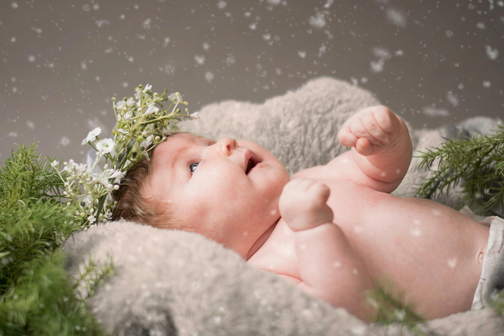 Baby looking up in wonder at new snowfall